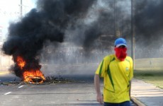 Brazil officials reverse subway and bus fare hikes as thousands protest