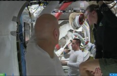NASA aborts spacewalk after helmet leak