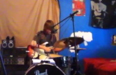 WATCH: Guys play the guitar and drums at the same time and sounds quite good