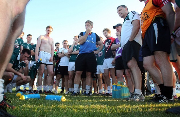Kieran McGeeney talks to his players after the game