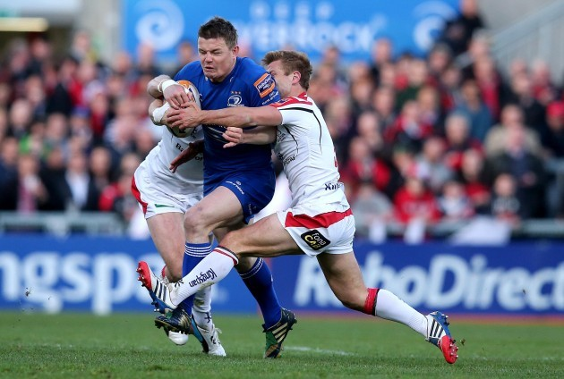 Brian O'Driscoll tackled by Tommy Bowe and Paul Marshall