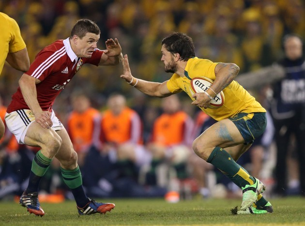 British and Irish Lion's Brian O'Driscoll confronts Australian Wallabies Adam Ashley-Cooper