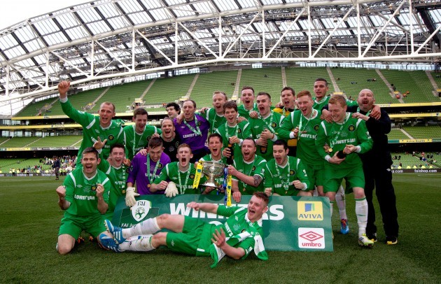 St Michael's team celebrate with the trophy