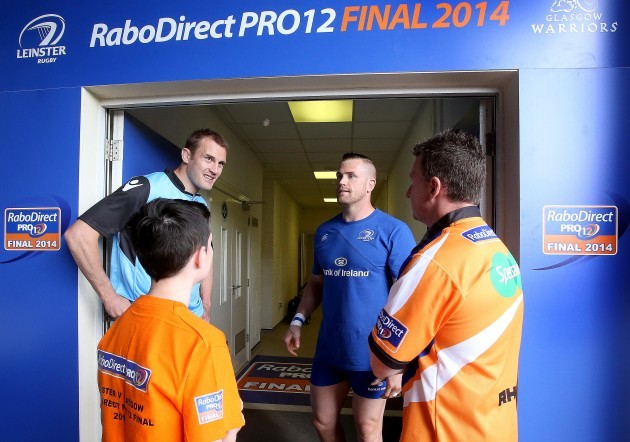 Jamie Heaslip and Al Kellock with referee Nigel Owens and fan Sean Fitzsimons