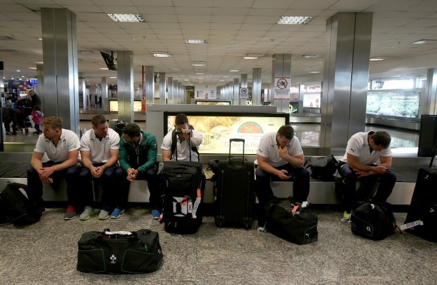 The Ireland players await their bags