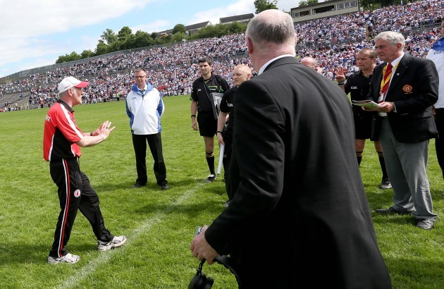 Mickey Harte confronts referee Eddie Kinsella at the end of the game