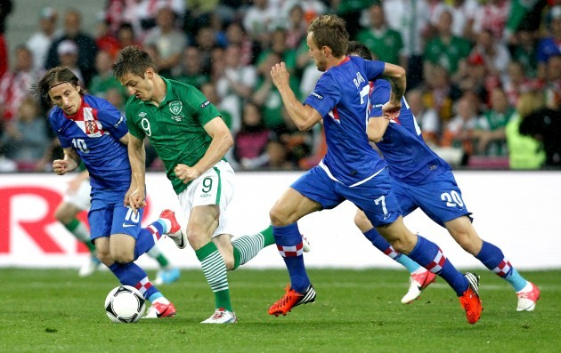 Kevin Doyle with Luka Modric, Ivan Perisic and Ivan Rakiticof