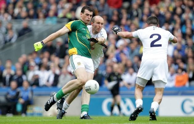 Paddy O'Rourke under pressure from Hugh McGrillen