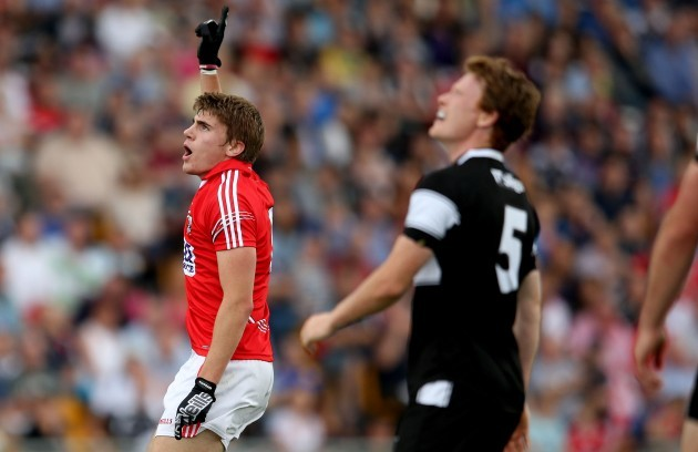 Ian Maguire celebrates scoring a point