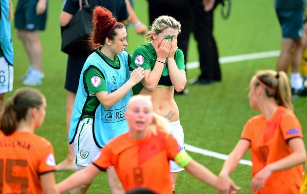 Savannah McCarthy is consoled by Shannon Carson after the game 24/7/2014