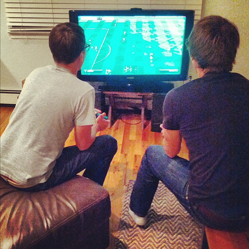 Me & @jcrowley playing FIFA. I'm sure there's a photo *exactly* like this from 1992 too (except we be on Sega Genesis)