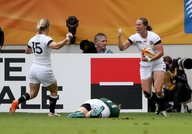 Emily Scarratt celebrates her try with Danielle Waterman