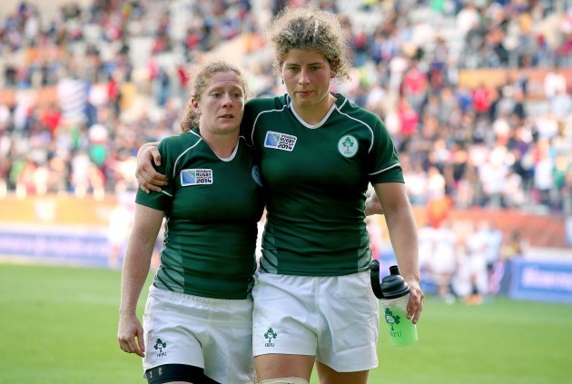 Grace Davitt and Jenny Murphy leave the field after the game
