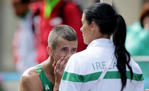 Rob Heffernan with Marian Heffernan after withdrawing from the race