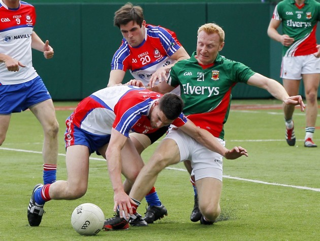 Brendan Quigley and Niall Farrell tackled Richie Feeney