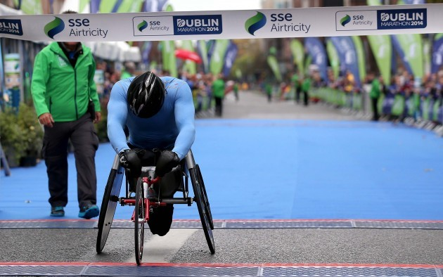 Patrick Monaghan crosses the line to win the Wheelchair Dublin Marathon