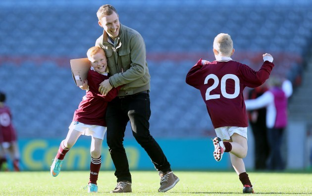 Quinn Berryman and Nathan Brophy celebrate with Teacher/Coach Ciaran Cronin at the final whistle