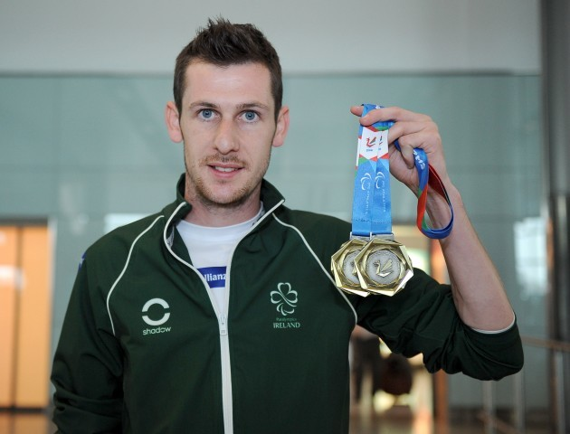 Michael McKillop displays his medal