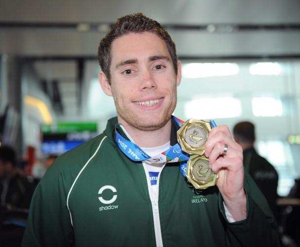 Jason Smyth displays his medal