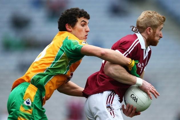 Daithi Burke tackles Paudie McGuigan