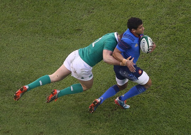 France's Wesley Fofana is tackled by IrelandÕs Robbie Henshaw