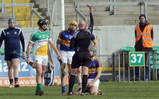 John Keenan shows a red a card to Cathal Barrett