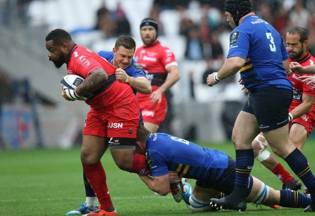 Mathieu Bastareaud is tackled by Jimmy Gopperth and Jordi Murphy
