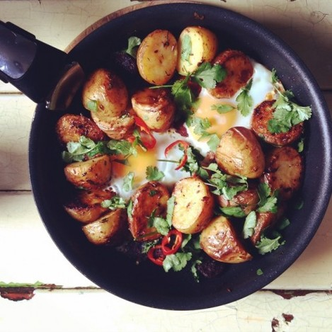 Brunch by @nialler9: leftover roast spuds fried up with chorizo, eggs, coriander and chilli served with Harissa yogurt OMG