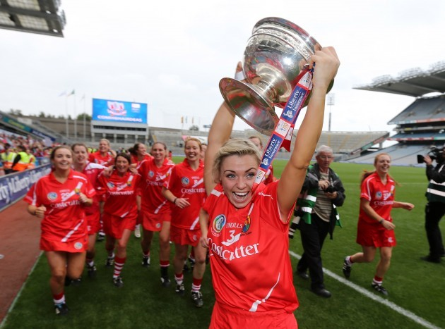 Anna Geary and the Cork players with the O'Duffy cup