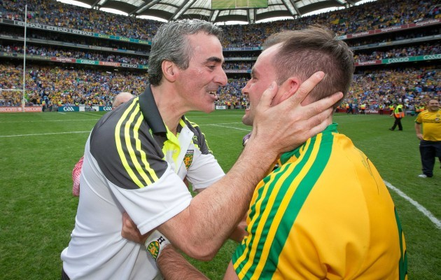 Jim McGuinness celebrates the final whistle with Karl Lacey
