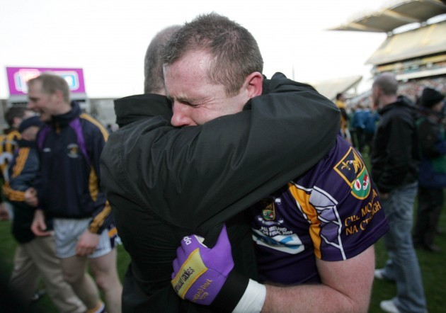 Pat Burke celebrates with his father Pat