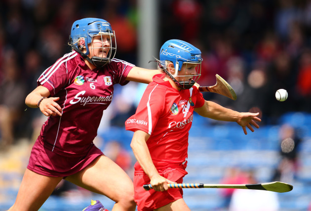 Briege Corkery solos past Shauna Healy