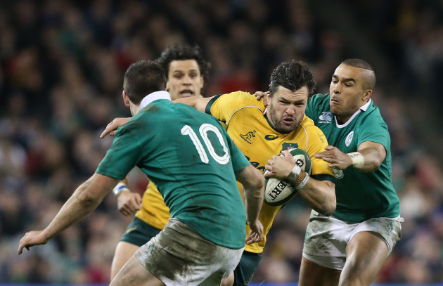 Adam Ashley-Cooper is tackled by Jonathan Sexton and Simon Zebo