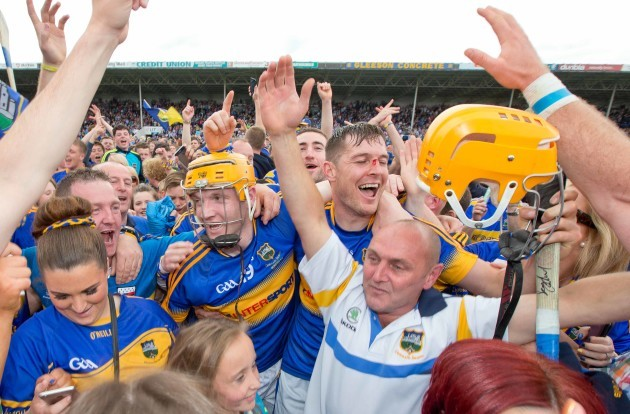 Lar Corbett and Seamus Callanan celebrate with fans after the game