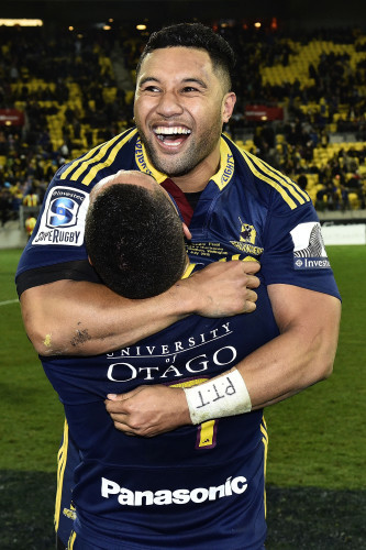 Lima Sopoaga celebrates winning with Aaron Smith
