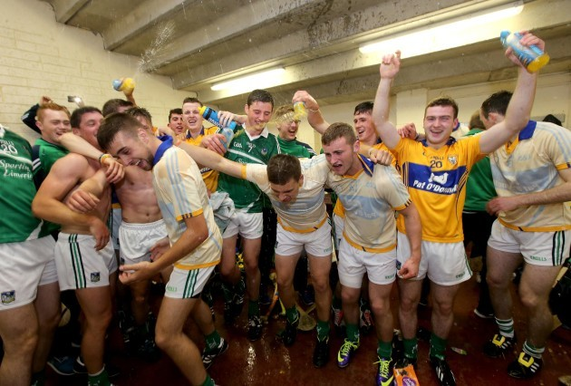 Clare player celebrate in the dressing rooms after the game