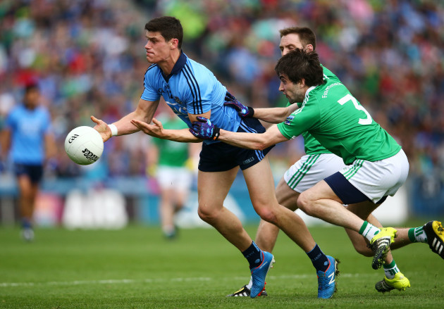 Diarmuid Connolly is tackled by Marty OÕBrien