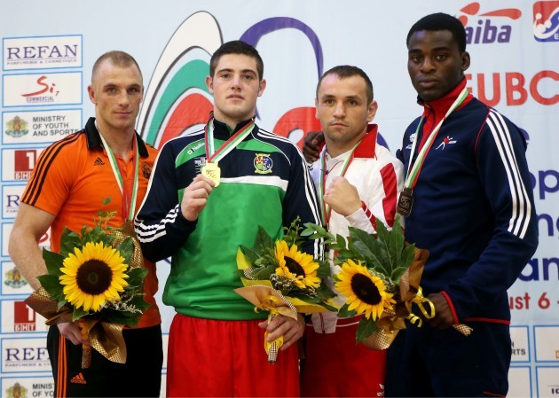 Joe Ward celebrates with his gold medal on the podium