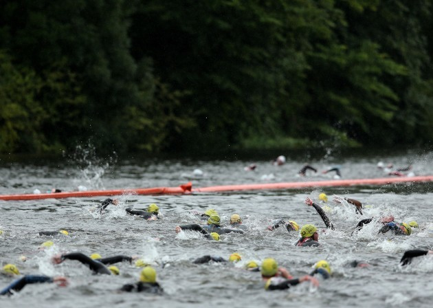 Competitors swim the Liffey during the Olympic distance