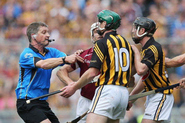 Barry Kelly attempts to separate Andy Smith and Henry Shefflin