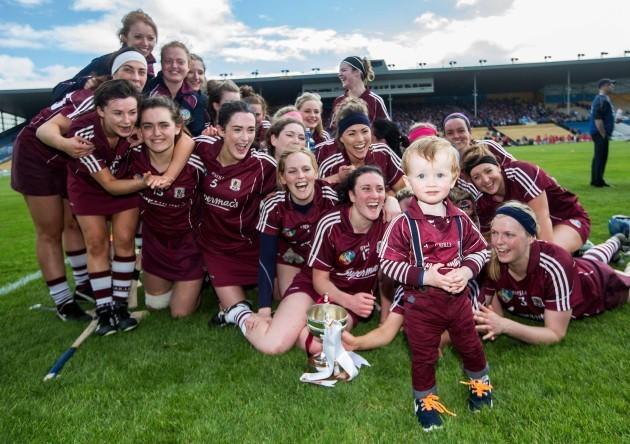 The Galway team celebrate as Tony Ward and grandson Oisin Helebert