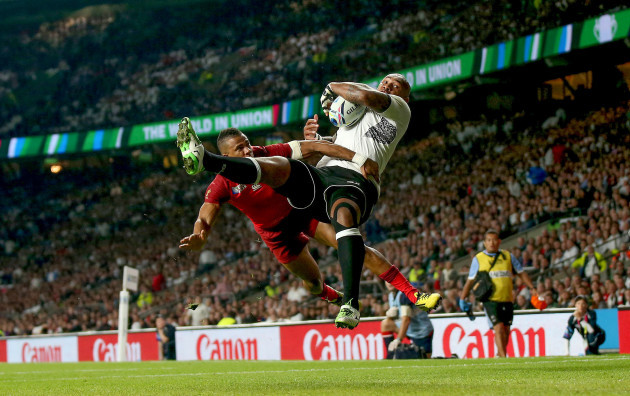Nemani Nadolo scores his side's first try despite Anthony Watson