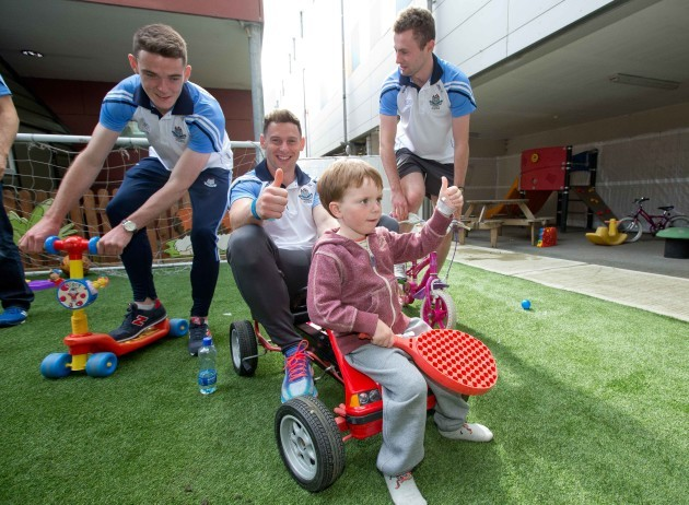 Brian Fenton, Philly McMahon and Jack McCaffrey with Donnchadh Mannion