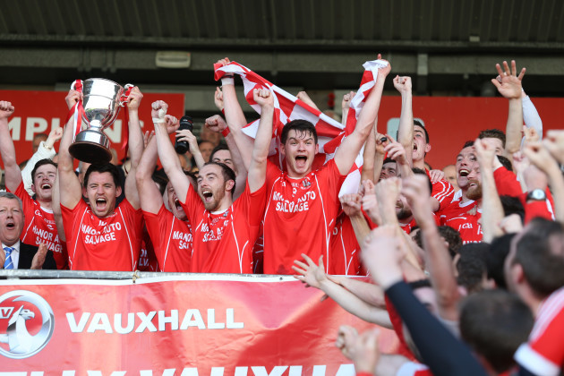 Matthew Donnelly lifts the cup