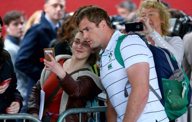 Jamie Heaslip poses for pictures with fans