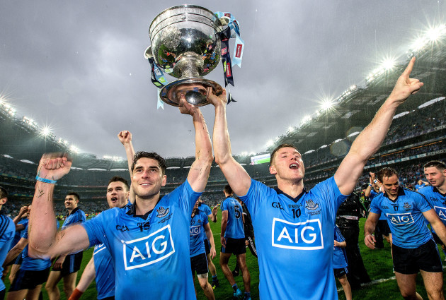 Bernard Brogan and Paul Flynn celebrates with the trophy