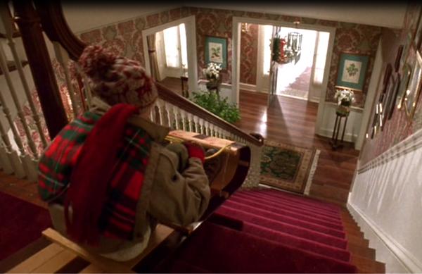 home-alone-macaulay-culkin-sled-stairs