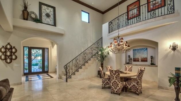 inside-wrought-iron-banisters-and-stucco-style-lofts-give-the-space-an-airy-feel