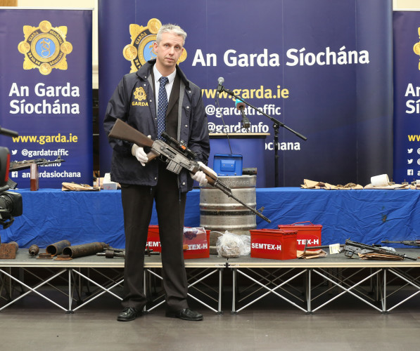 6/1/2016 Detective Garda Shay O Donnell holds a AK