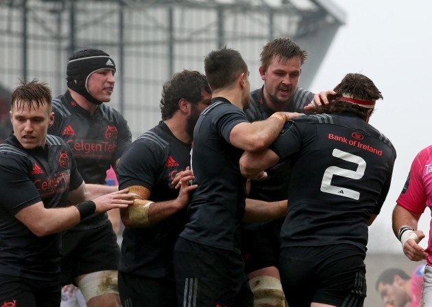 Mike Sherry celebrates with his teammates after scoring the first try